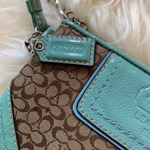 Coach Bags - Small Coach wristlet, teal and tan
